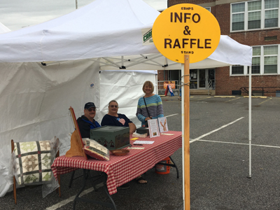 Volunteers at work at Fall Festival 2018 Information Booth